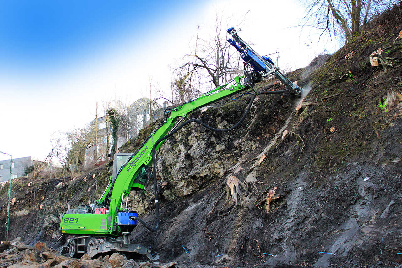 Excavator with drill function